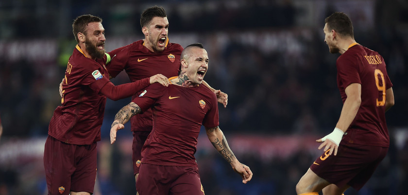 Roma's midfielder from Belgium Radja Nianggolan (2R) celebrates with teammates after scoring during the Italian Serie A football match Roma vs AC Milan at the Olympic Stadium in Roma on December 12, 2016. / AFP / FILIPPO MONTEFORTE        (Photo credit should read FILIPPO MONTEFORTE/AFP/Getty Images)