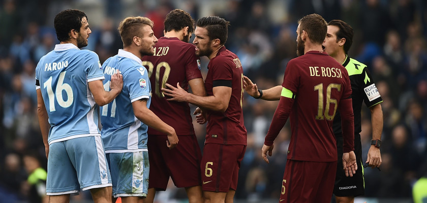 Lazio's midfielder from Italy Marco Parolo (L) and Lazio's forward from Italy Ciro Immobile (2ndL) argue with Roma's defender from Argentina Federico Fazio (C), Roma's midfielder from Netherlands Kevin Strootman (6) and Roma's midfielder from Italy Daniele De Rossi as Roma's defender from Greece Kostas Manolas (bottom) lies on the ground during the Italian Serie A football match SS Lazio vs AS Roma on December 4, 2016 at the Olympic stadium in Rome.  / AFP / FILIPPO MONTEFORTE        (Photo credit should read FILIPPO MONTEFORTE/AFP/Getty Images)
