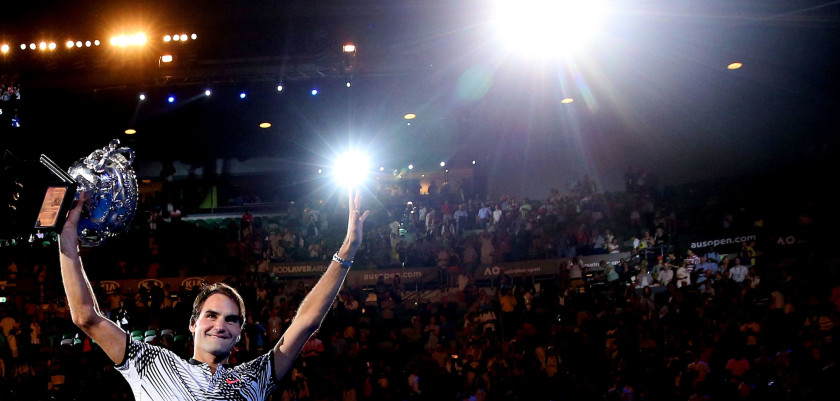 MELBOURNE, AUSTRALIA - JANUARY 29:  Roger Federer of Switzerland waves to fans in the crowd as he does a lap of honour with the Norman Brookes Challenge Cup after winning the Men's Final match against Rafael Nadal of Spain on day 14 of the 2017 Australian Open at Melbourne Park on January 29, 2017 in Melbourne, Australia.  (Photo by Scott Barbour/Getty Images)