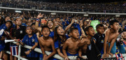 Thai football fans celebrate after Thailand won the AFF Suzuki Cup Final between Thailand and Indonesia at Rajamangala Stadium in Bangkok on December 17, 2016. / AFP / LILLIAN SUWANRUMPHA        (Photo credit should read LILLIAN SUWANRUMPHA/AFP/Getty Images)