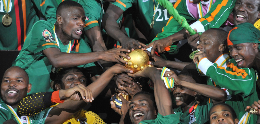 Zambia national football team players celebrate their victory with their trophy at the end of the African Cup of Nations final football match between Zambia and Ivory Coast on February 12, 2012, at the Stade de l'Amitie in Libreville. AFP PHOTO / ISSOUF SANOGO (Photo credit should read ISSOUF SANOGO/AFP/Getty Images)