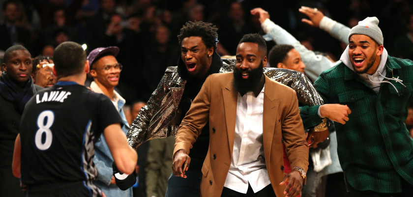 TORONTO, ON - FEBRUARY 13: Andrew Wiggins of the Minnesota Timberwolves, James Harden of the Houston Rockets and Karl-Anthony Towns of the Minnesota Timberwolves react after a dunk by Zach LaVine of the Minnesota Timberwolves in the Verizon Slam Dunk Contest during NBA All-Star Weekend 2016 at Air Canada Centre on February 13, 2016 in Toronto, Canada. NOTE TO USER: User expressly acknowledges and agrees that, by downloading and/or using this Photograph, user is consenting to the terms and conditions of the Getty Images License Agreement.  (Photo by Elsa/Getty Images)