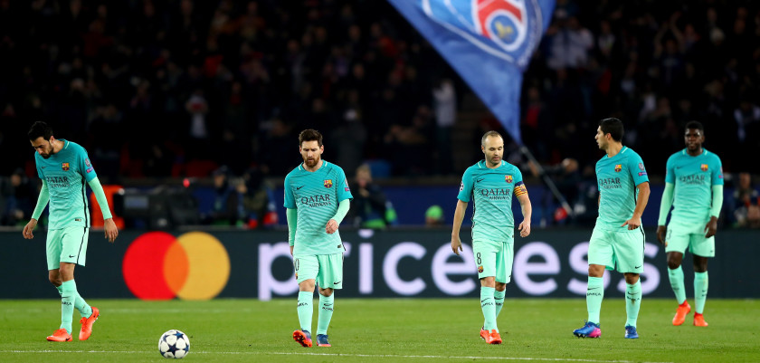 PARIS, FRANCE - FEBRUARY 14:  L-R) Sergio Busquets, Lionel Messi, Andres Iniesta, Luis Suarez and Samuel Umtiti of Barcelona react after conceding a goal during the UEFA Champions League Round of 16 first leg match between Paris Saint-Germain and FC Barcelona at Parc des Princes on February 14, 2017 in Paris, France.  (Photo by Clive Rose/Getty Images)