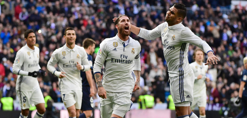 Real Madrid's defender Sergio Ramos (L) celebrates with Real Madrid's Brazilian midfielder Casemiro after scoring  during the Spanish league football match Real Madrid CF vs Malaga CF at the Santiago Bernabeu stadium in Madrid on January 21, 2017. / AFP / PIERRE-PHILIPPE MARCOU        (Photo credit should read PIERRE-PHILIPPE MARCOU/AFP/Getty Images)