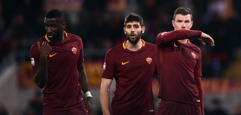 Roma's forward from Bosnia-Herzegovina Edin Dzeko (R), defender from Argentina Federico Fazio (C) and defender from Grermany Antonio Rudiger (L) react during the Italian Serie A football match Roma vs Fiorentina at the Olympic Stadium in Rome on February 7, 2017.  Roma won the match 4-0. / AFP / FILIPPO MONTEFORTE        (Photo credit should read FILIPPO MONTEFORTE/AFP/Getty Images)