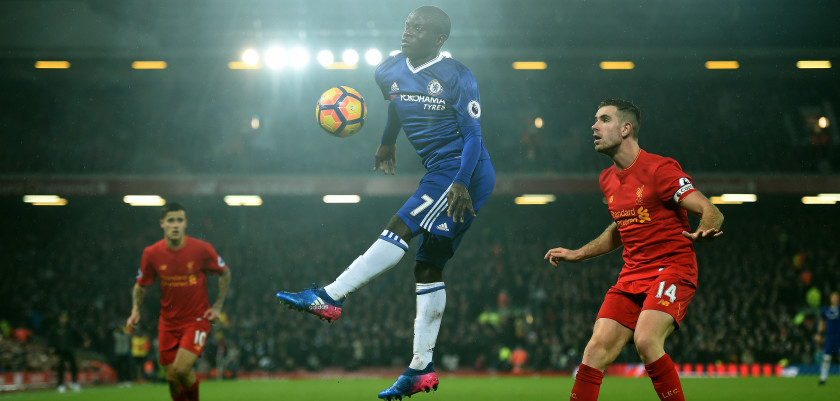 Chelsea's French midfielder N'Golo Kante (C) controls the ball during the English Premier League football match between Liverpool and Chelsea at Anfield in Liverpool, north west England on January 31, 2017. The match ended in a draw at 1-1. / AFP / Paul ELLIS / RESTRICTED TO EDITORIAL USE. No use with unauthorized audio, video, data, fixture lists, club/league logos or 'live' services. Online in-match use limited to 75 images, no video emulation. No use in betting, games or single club/league/player publications.  /         (Photo credit should read PAUL ELLIS/AFP/Getty Images)