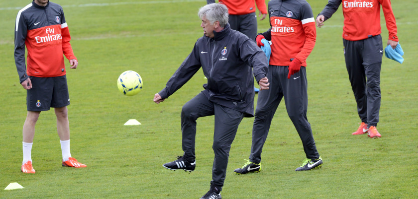 Paris Saint-Germain's coach Carlo Ancelotti juggles next to Argentinian midfielder Javier Pastore (2ndR), French midfielder Clement Chantome (R) and French midfielder Jeremy Menez during a training session on May 10, 2013 at PSG training camp in Saint-Germain-en-Laye, outside Paris.     AFP PHOTO / BERTRAND GUAY        (Photo credit should read BERTRAND GUAY/AFP/Getty Images)