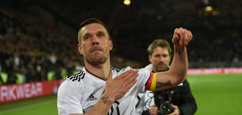 Germany's midfielder Lukas Podolski greets fans after a friendly football match between Germany and England on March 22, 2017 in Dortmund, western Germany.  It is Lukas Podolski's last match with the German team. / AFP PHOTO / PATRIK STOLLARZ        (Photo credit should read PATRIK STOLLARZ/AFP/Getty Images)