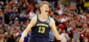 INDIANAPOLIS, IN - MARCH 19:  Moritz Wagner #13 of the Michigan Wolverines celebrates against the Louisville Cardinals during the second round of the NCAA Basketball Tournament at Bankers Life Fieldhouse on March 19, 2017 in Indianapolis, Indiana.  (Photo by Andy Lyons/Getty Images)