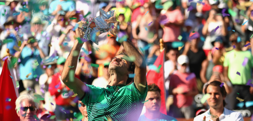 INDIAN WELLS, CA - MARCH 19:  Roger Federer of Switzerland holds the BNP Paribas Open trophy aloft after his straight sets victory against Stanislas Wawrinka of Switzerland in the mens final during day fourteen of the BNP Paribas Open at Indian Wells Tennis Garden on March 19, 2017 in Indian Wells, California.  (Photo by Clive Brunskill/Getty Images)