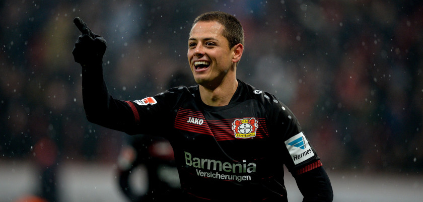 Leverkusen's Mexican forward Javier Hernandez (Chicharito) celebrates scoring the 2-0 during the German First division Bundesliga football match between Bayer Leverkusen and Eintracht Frankfurt in Leverkusen, western Germany, on February 11, 2017. / AFP / SASCHA SCHUERMANN / RESTRICTIONS: DURING MATCH TIME: DFL RULES TO LIMIT THE ONLINE USAGE TO 15 PICTURES PER MATCH AND FORBID IMAGE SEQUENCES TO SIMULATE VIDEO. == RESTRICTED TO EDITORIAL USE == FOR FURTHER QUERIES PLEASE CONTACT DFL DIRECTLY AT + 49 69 650050         (Photo credit should read SASCHA SCHUERMANN/AFP/Getty Images)