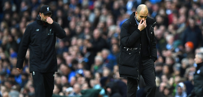 Liverpool's German manager Jurgen Klopp (L) and Manchester City's Spanish manager Pep Guardiola leave the pitch after the first half during the English Premier League football match between Manchester City and Liverpool at the Etihad Stadium in Manchester, north west England, on March 19, 2017. / AFP PHOTO / Paul ELLIS / RESTRICTED TO EDITORIAL USE. No use with unauthorized audio, video, data, fixture lists, club/league logos or 'live' services. Online in-match use limited to 75 images, no video emulation. No use in betting, games or single club/league/player publications.  /         (Photo credit should read PAUL ELLIS/AFP/Getty Images)