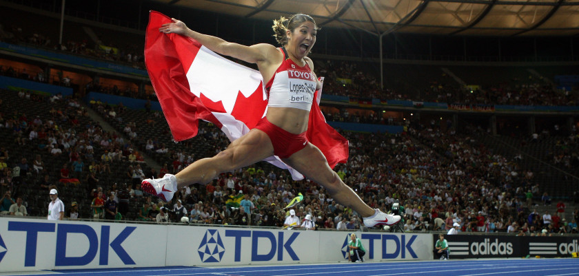 BERLIN - AUGUST 19:  Priscilla Lopes-Schliep of Canada celebrates winning the silver medal in the women's 100 Metres Hurdles Final during day five of the 12th IAAF World Athletics Championships at the Olympic Stadium on August 19, 2009 in Berlin, Germany.  (Photo by Mark Dadswell/Getty Images)