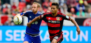 Leverkusen's midfielder Benjamin Henrichs (R) and Ingolstadt's Moritz Hartmann vie for the ball during the German first division Bundesliga football match between Bayer 04 Leverkusen and FC Ingolstadt 04, in Leverkusen, western Germany, on May 14, 2016. / AFP / Sascha SCH��RMANN / RESTRICTIONS: DURING MATCH TIME: DFL RULES TO LIMIT THE ONLINE USAGE TO 15 PICTURES PER MATCH AND FORBID IMAGE SEQUENCES TO SIMULATE VIDEO. == RESTRICTED TO EDITORIAL USE == FOR FURTHER QUERIES PLEASE CONTACT DFL DIRECTLY AT + 49 69 650050         (Photo credit should read SASCHA SCHURMANN/AFP/Getty Images)