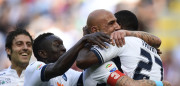 Empoli's Senegalese forward Mame Baba Thiam (R) is congratulated by Empoli's Italian forward Massimo Maccarone and teammates during the Italian Serie A football match AC Milan vs Empoli at the San Siro stadium in Milan on April 23, 2017. / AFP PHOTO / MIGUEL MEDINA        (Photo credit should read MIGUEL MEDINA/AFP/Getty Images)