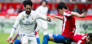 GIJON, SPAIN - APRIL 15:  Isco of Real Madrid duels for the ball with Jorge Mere of Real Sporting de Gijon during the La Liga match between Real Sporting de Gijon and Real Madrid at Estadio El Molinon on April 15, 2017 in Gijon, Spain.  (Photo by Juan Manuel Serrano Arce/Getty Images)