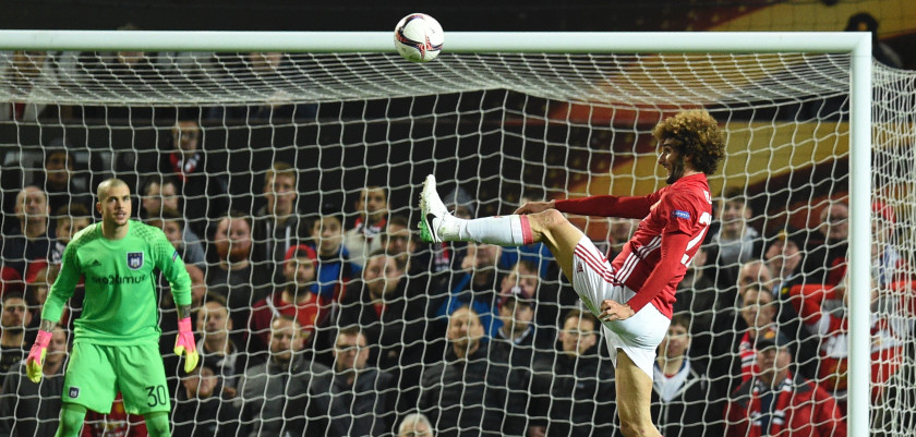 TOPSHOT - Manchester United's Belgian midfielder Marouane Fellaini controls the ball during the UEFA Europa League quarter-final second leg football match between Manchester United and Anderlecht at Old Trafford in Manchester, north west England, on April 20, 2017. / AFP PHOTO / Oli SCARFF        (Photo credit should read OLI SCARFF/AFP/Getty Images)