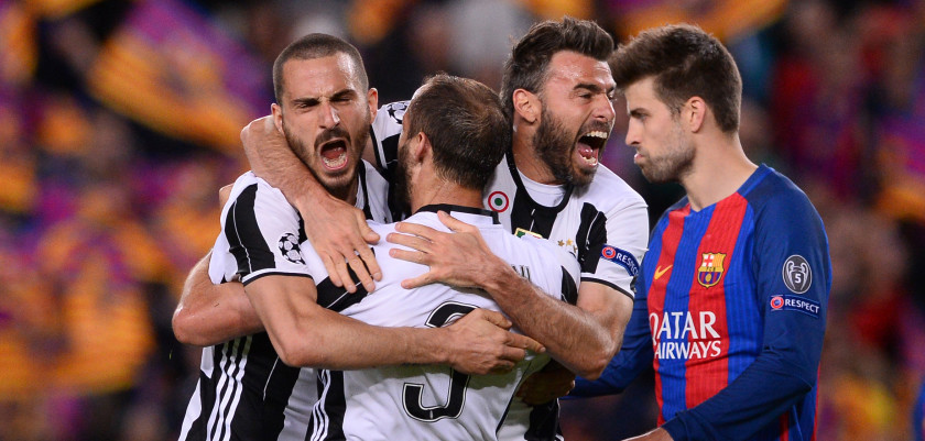 TOPSHOT - Juventus' defender Giorgio Chiellini (2ndL) celebrates their qualification with Juventus' defender Andrea Barzagli (2ndR) and a teammate at the end of the UEFA Champions League quarter-final second leg football match FC Barcelona vs Juventus at the Camp Nou stadium in Barcelona on April 19, 2017. / AFP PHOTO / Josep LAGO        (Photo credit should read JOSEP LAGO/AFP/Getty Images)