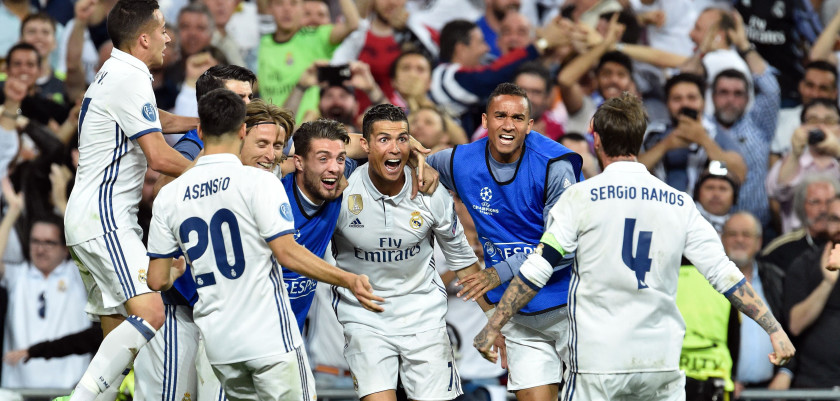 TOPSHOT - Real Madrid's Portuguese forward Cristiano Ronaldo (C) celebrates after scoring during the UEFA Champions League quarter-final second leg football match Real Madrid vs FC Bayern Munich at the Santiago Bernabeu stadium in Madrid in Madrid on April 18, 2017. / AFP PHOTO / GERARD JULIEN        (Photo credit should read GERARD JULIEN/AFP/Getty Images)
