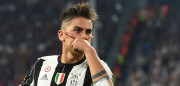 Juventus' forward from Argentina Paulo Dybala celebrates after scoring during the UEFA Champions League quarter final first leg football match Juventus vs Barcelona, on April 11, 2017 at the Juventus stadium in Turin.  / AFP PHOTO / GIUSEPPE CACACE        (Photo credit should read GIUSEPPE CACACE/AFP/Getty Images)