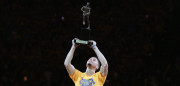 OAKLAND, CA - MAY 11:  Stephen Curry #30 of the Golden State Warriors lifts up his MVP trophy before their game against the Portland Trail Blazers in Game Five of the Western Conference Semifinals during the 2016 NBA Playoffs on May 11, 2016 at Oracle Arena in Oakland, California.  NOTE TO USER: User expressly acknowledges and agrees that, by downloading and or using this photograph, User is consenting to the terms and conditions of the Getty Images License Agreement.  (Photo by Ezra Shaw/Getty Images)