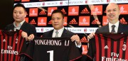 "Head of Rossoneri Sport Investment Lux, Chinese businessman and new owner of the AC Milan football club, Yonghong Li (C) poses with Italian businessman Marco Fassone (R) and Rossoneri Sport Investment Lux representative David Han Li (L) during a press conference on April 14, 2017 in Milan.  Serie A giants AC Milan were sold to Rossoneri Sport Investment Lux yesterday in a deal which sees the Chinese-led consortium take a 99.9% stake in the club. The seven-time European champions who are Italy's most succcessful club in international competition, have been owned by former three-time Italy prime minister Silvio Berlusconi since 1986. A joint statement by AC Milan's holding company Fininvest and Rossoneri Sport Investment Lux said on April 13, 2017 : ""Today Fininvest has completed the sale of the entire stake owned in AC Milan - equal to 99.93% - to Rossoneri Sport Investment Lux.""  / AFP PHOTO / MIGUEL MEDINA        (Photo credit should read MIGUEL MEDINA/AFP/Getty Images)"