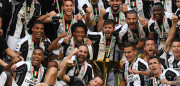 TURIN, ITALY - MAY 21:  Juventus FC players celebrate with the trophy after the beating FC Crotone 3-0 to win the Serie A Championships at the end of the Serie A match between Juventus FC and FC Crotone at Juventus Stadium on May 21, 2017 in Turin, Italy.  (Photo by Valerio Pennicino/Getty Images)