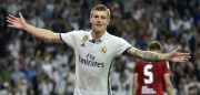 Real Madrid's German midfielder Toni Kroos celebrates after scoring a goal during the Spanish league football match Real Madrid CF vs Sevilla FC at the Santiago Bernabeu stadium in Madrid on May 14, 2017. Real Madrid won 4-1. / AFP PHOTO / GERARD JULIEN        (Photo credit should read GERARD JULIEN/AFP/Getty Images)