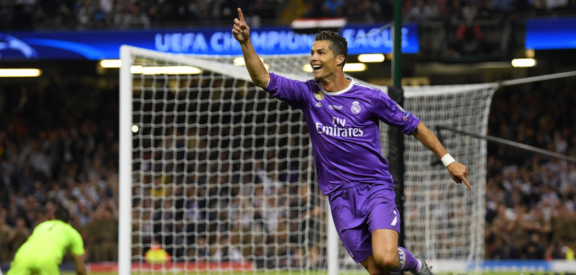 CARDIFF, WALES - JUNE 03: Cristiano Ronaldo of Real Madrid celebrates scoring his sides third goal during the UEFA Champions League Final between Juventus and Real Madrid at National Stadium of Wales on June 3, 2017 in Cardiff, Wales.  (Photo by Matthias Hangst/Getty Images)