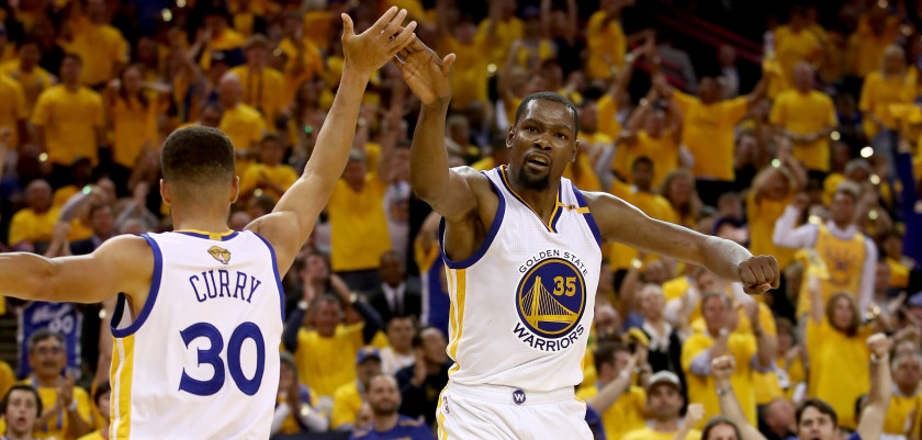 OAKLAND, CA - JUNE 04:  Stephen Curry #30 and Kevin Durant #35 of the Golden State Warriors react to a play against the Cleveland Cavaliers in Game 2 of the 2017 NBA Finals at ORACLE Arena on June 4, 2017 in Oakland, California. NOTE TO USER: User expressly acknowledges and agrees that, by downloading and or using this photograph, User is consenting to the terms and conditions of the Getty Images License Agreement.  (Photo by Ezra Shaw/Getty Images)