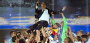 Real Madrid's French coach Zinedine Zidane is tossed by players as they celebrate the team's win, at the Santiago Bernabeu stadium in Madrid on June 4, 2017 after winning the UEFA Champions League football match final Juventus vs Real Madrid CF held at the National Stadium of Wales in Cardiff on June 3, 2017. / AFP PHOTO / CURTO DE LA TORRE        (Photo credit should read CURTO DE LA TORRE/AFP/Getty Images)