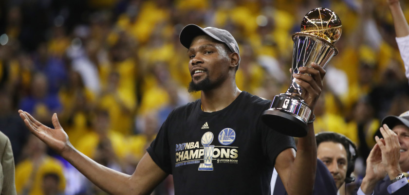 OAKLAND, CA - JUNE 12:  Kevin Durant #35 of the Golden State Warriors celebrates after being named Bill Russell NBA Finals Most Valuable Player after defeating the Cleveland Cavaliers 129-120 in Game 5 to win the 2017 NBA Finals at ORACLE Arena on June 12, 2017 in Oakland, California. NOTE TO USER: User expressly acknowledges and agrees that, by downloading and or using this photograph, User is consenting to the terms and conditions of the Getty Images License Agreement.  (Photo by Ezra Shaw/Getty Images)