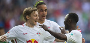 Leipzig's Guinean midfielder Naby Keita (R) celebrates with his teammates Swedish forward Emil Forsberg (L) and Danish forward Yussuf Poulsen (C) after scoring the 4-0 during the German first division Bundesliga football match between RB Leipzig and SV Darmstadt 98 in Leipzig, eastern Germany, on April 1, 2017. / AFP PHOTO / ROBERT MICHAEL / RESTRICTIONS: DURING MATCH TIME: DFL RULES TO LIMIT THE ONLINE USAGE TO 15 PICTURES PER MATCH AND FORBID IMAGE SEQUENCES TO SIMULATE VIDEO. == RESTRICTED TO EDITORIAL USE == FOR FURTHER QUERIES PLEASE CONTACT DFL DIRECTLY AT + 49 69 650050         (Photo credit should read ROBERT MICHAEL/AFP/Getty Images)