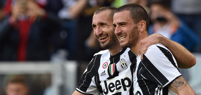 TURIN, ITALY - MAY 14:  Giorgio Chiellini (L) of Juventus FC celebrates after a goal with team mate Leonardo Bonucci during the Serie A match between Juventus FC and UC Sampdoria at Juventus Arena on May 14, 2016 in Turin, Italy.  (Photo by Valerio Pennicino/Getty Images)