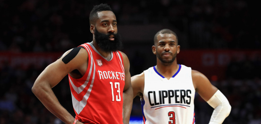 LOS ANGELES, CA - APRIL 10:  James Harden #13 of the Houston Rockets and Chris Paul #3 of the LA Clippers look on during the second  half of a game at Staples Center on April 10, 2017 in Los Angeles, California.  NOTE TO USER: User expressly acknowledges and agrees that, by downloading and or using this Photograph, user is consenting to the terms and conditions of the Getty Images License Agreement  (Photo by Sean M. Haffey/Getty Images)