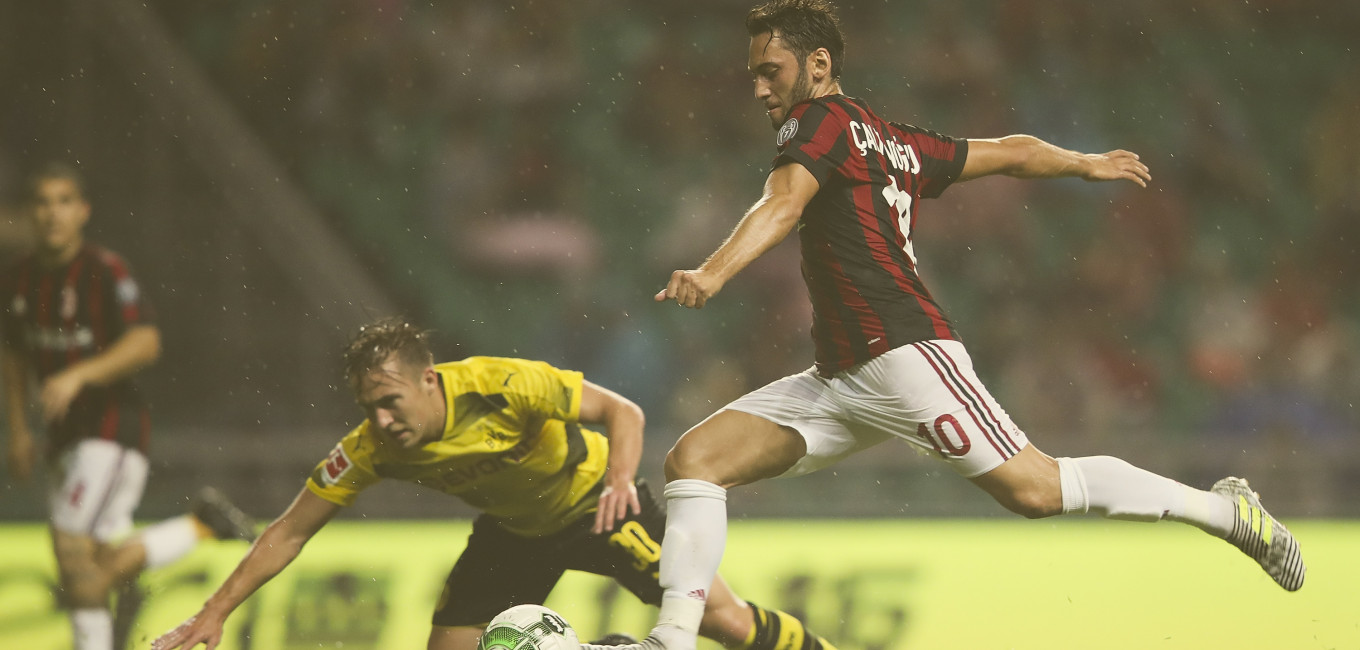 GUANGZHOU, CHINA - JULY 18:  Hakan Calhanoglu of AC Milan in action during the 2017 International Champions Cup football match between AC milan and Borussia Dortmund at University Town Sports Centre Stadium on July 18, 2017 in Guangzhou, China.  (Photo by Lintao Zhang/Getty Images)