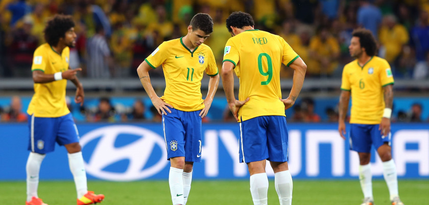 BELO HORIZONTE, BRAZIL - JULY 08:  Oscar and Fred of Brazil prepare to kick off after a goal during the 2014 FIFA World Cup Brazil Semi Final match between Brazil and Germany at Estadio Mineirao on July 8, 2014 in Belo Horizonte, Brazil.  (Photo by Martin Rose/Getty Images)