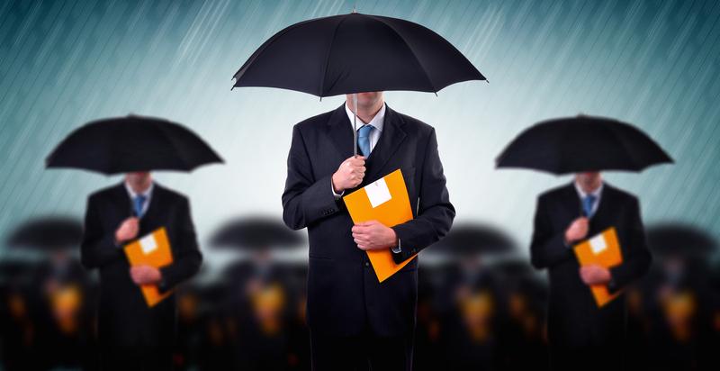 3 men in suits holding umbrellas