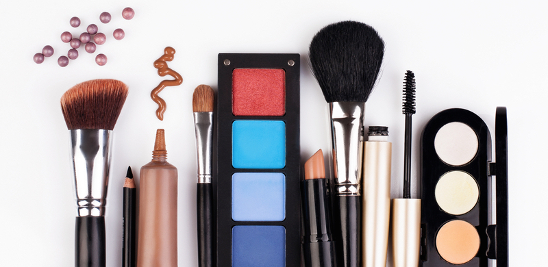 variety of cosmetics and makeup brushes