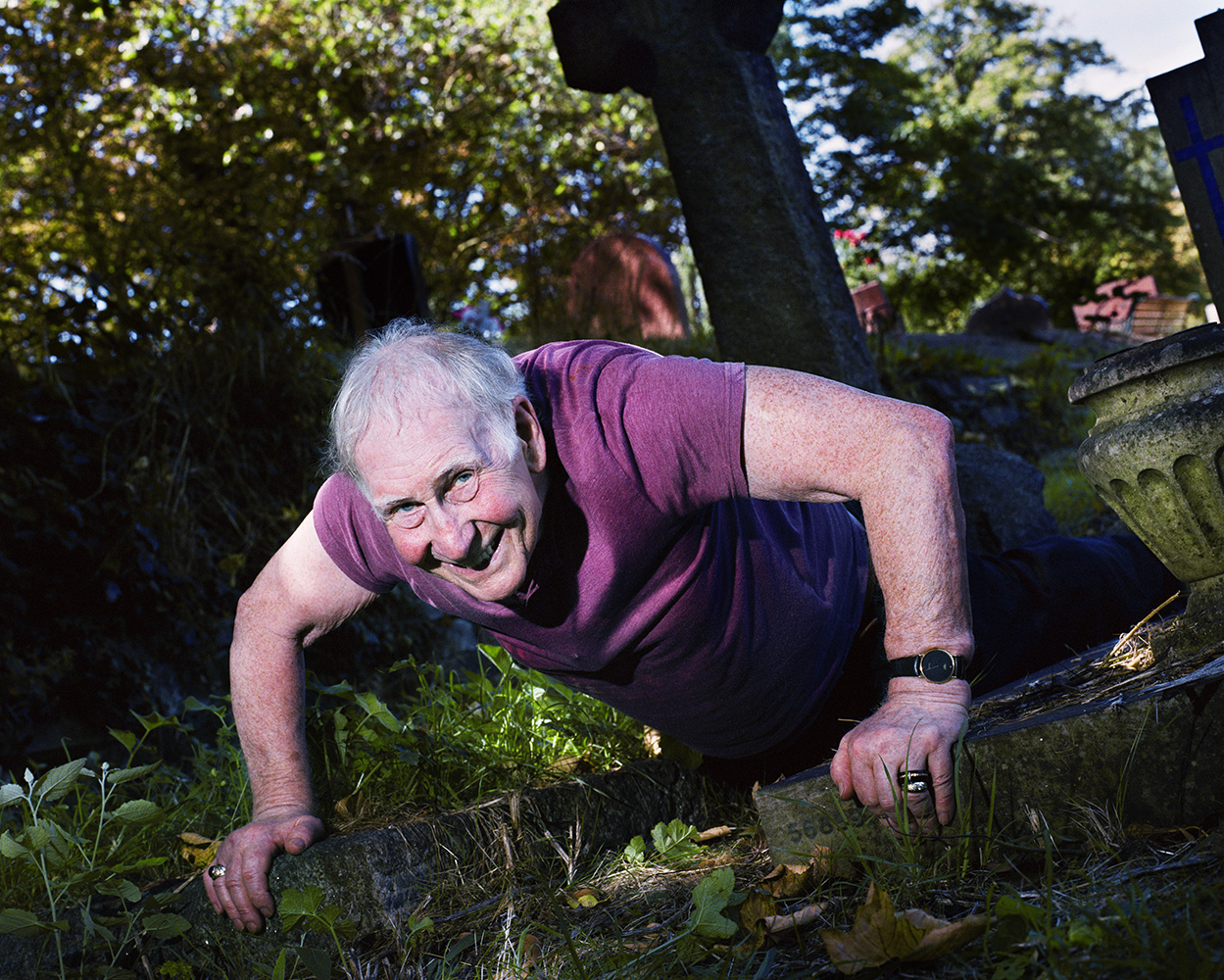 Man-Exercising-Between-Graves_piotrKarpi