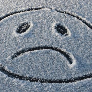 sad face in the snow