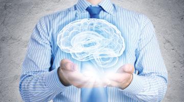man holding a brain