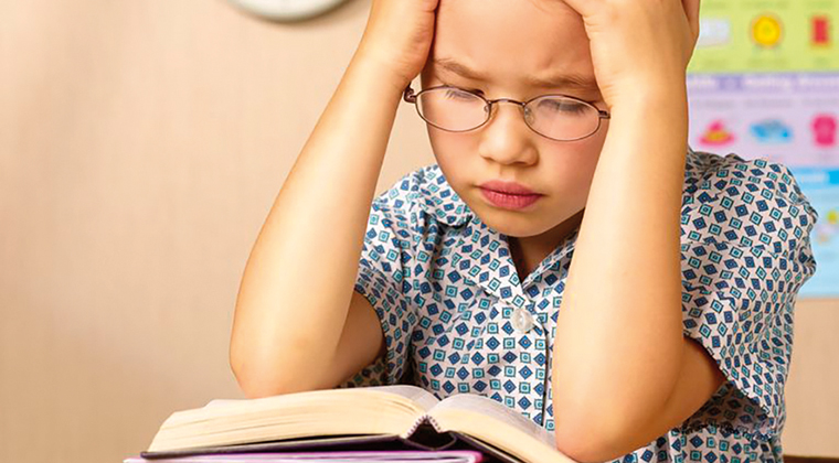 child-tired-reading