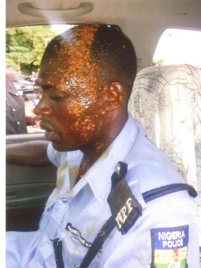 man baths police with hot soup