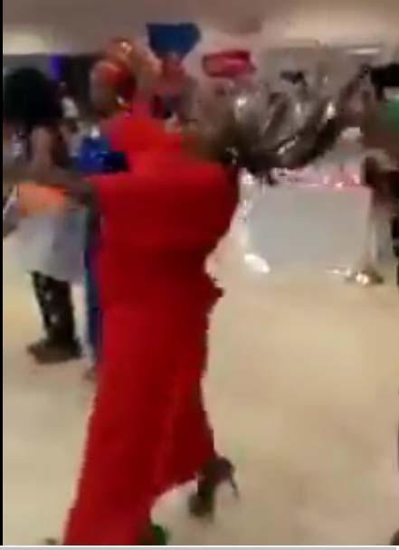 Nigerian woman spray money