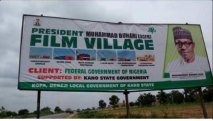 film village sign post