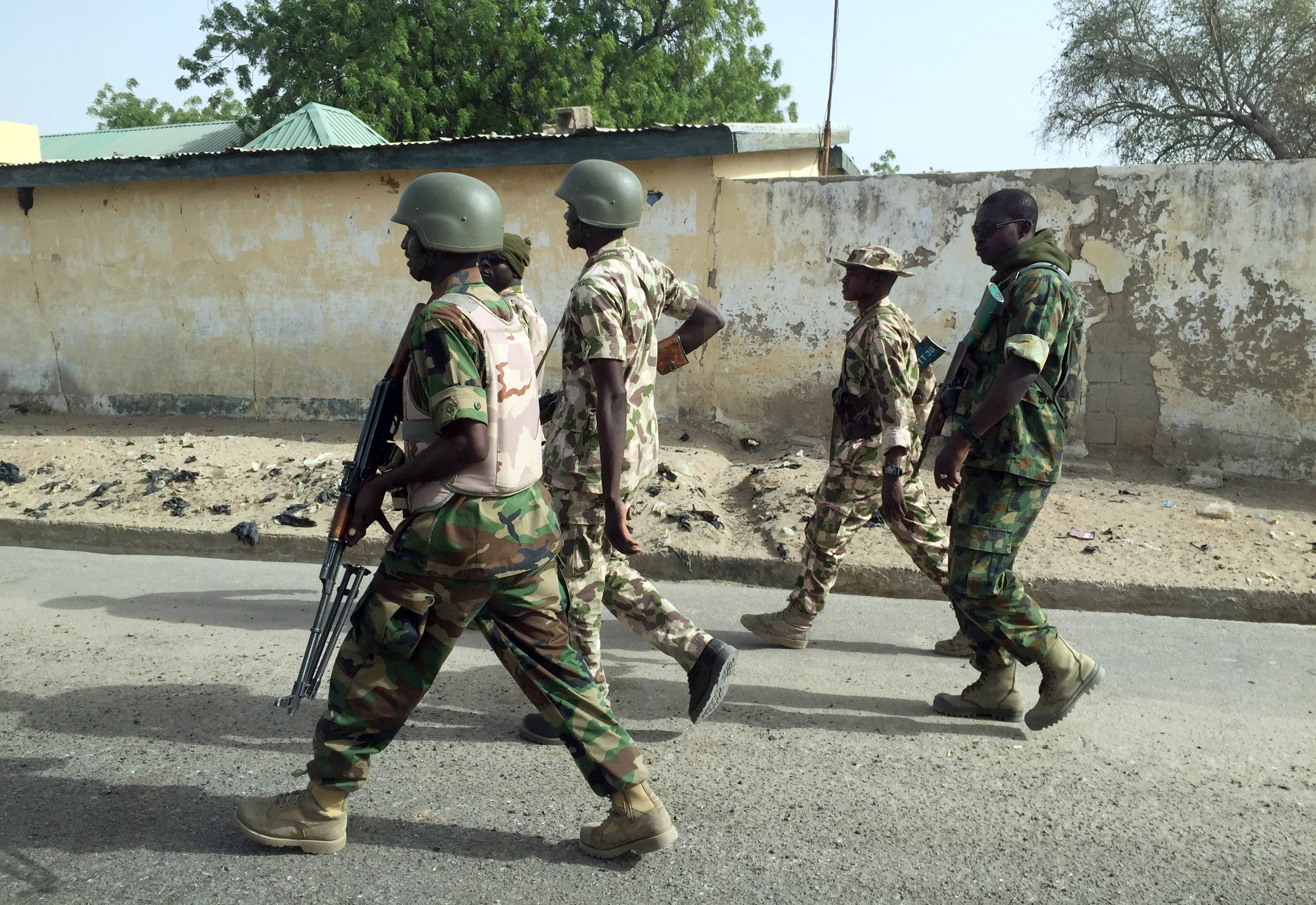 "A handout photo released by the Nigerian Army shows Nigerian soldiers in Goniri on March 16, 2015. Nigeria's military on March 16 said that it had cleared Boko Haram from the northeastern state of Yobe, after reclaiming the town of Goniri. AFP PHOTO / NIGERIAN ARMY  -- RESTRICTED TO EDITORIAL USE - NO ADVERTISING CAMPAIGN - NO MARKETING - MANDATORY CREDIT  ""AFP PHOTO / NIGERIAN ARMY "" - DISTRIBUTED AS A SERVICE TO CLIENTS --"