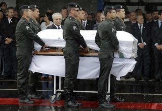 President Michel Temer attends the arrival ceremony of the coffins with the remains of Chapecoense soccer team victims, in Chapeco, Brazil, Saturday, Dec. 3, 2016. (AP Photo/Andre Penner)