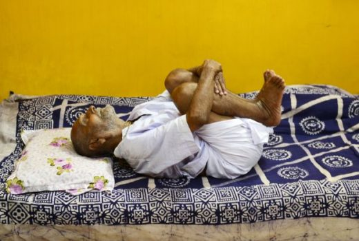 In this photograph taken on August 2, 2016, Indian monk Swami Sivananda, who claims to be 120 years old, practises yoga in Kolkata.  An Indian monk who claims to be the oldest man to have ever lived at 120 years, says he owes his longevity to daily yoga and a life without sex or spices. Born on August 8, 1896, according to his passport, Hindu monk Swami Sivananda's life has spanned three centuries. He is now applying to Guinness World Records to stake his claim to the distinction.   / AFP PHOTO / Dibyangshu SARKAR / TO GO WITH AFP STORY:  ' India-Lifestyle-Oldest-Man' Feature by Dibyangshu SARKAR