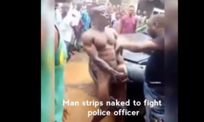 Naked man fights Police officer